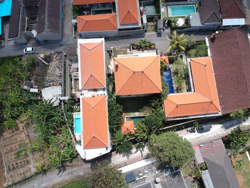 Buying land in Bali. A bird's eye eye of our current home in Bali. Our villa is in the middle with newly constructed villas surrounding us.