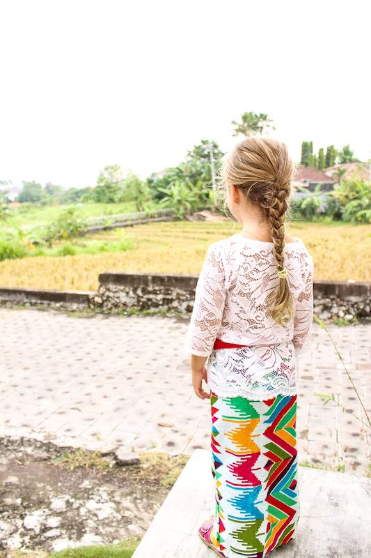 Buying land in Bali. The good old days! My daughter looks out from our front steps onto our neighbouring rice field.