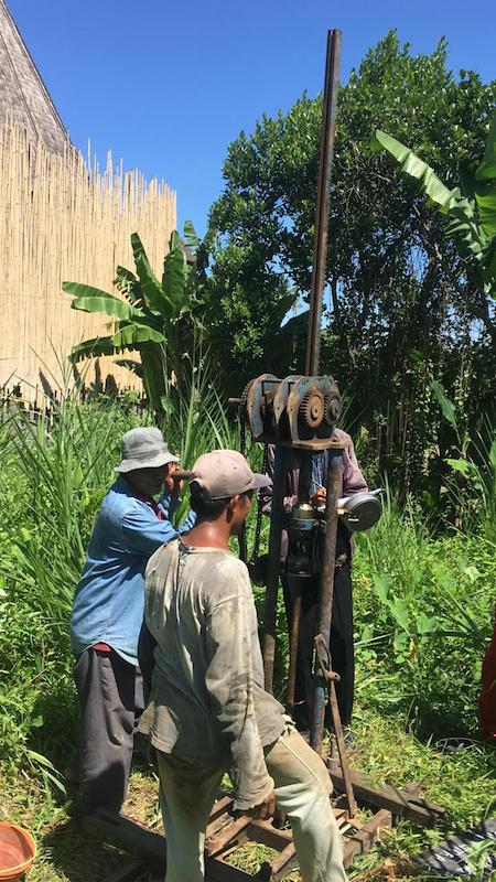Buying land in Bali. The surveying crew hack their way in to take soil samples.